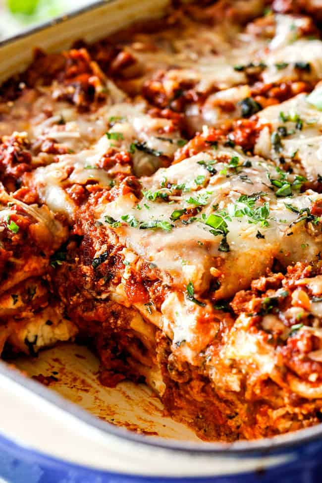 up close of side view of meat lasagna recipe cut into square serving slices