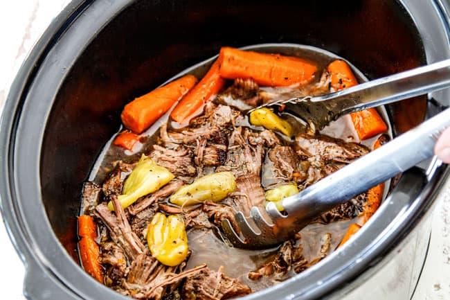 tongs taking Mississippi Pot Roast from crock pot