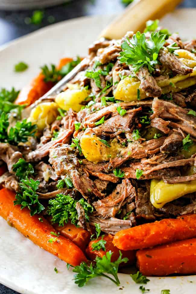 up close of Mississippi Pot Roast with carrots on a white platter