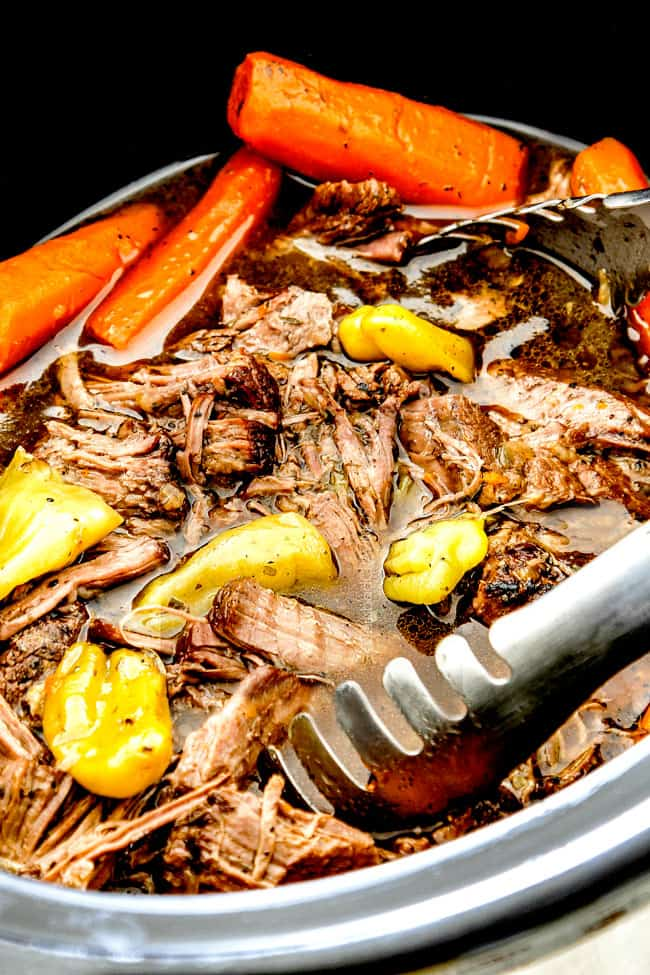 up close of tongs scooping Mississippi Pot Roast from crock pot