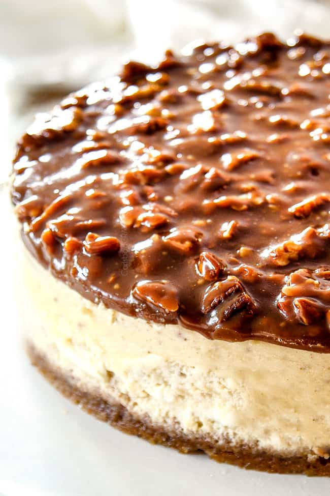 side view of pecan pie cheesecake with graham cracker crust recipe