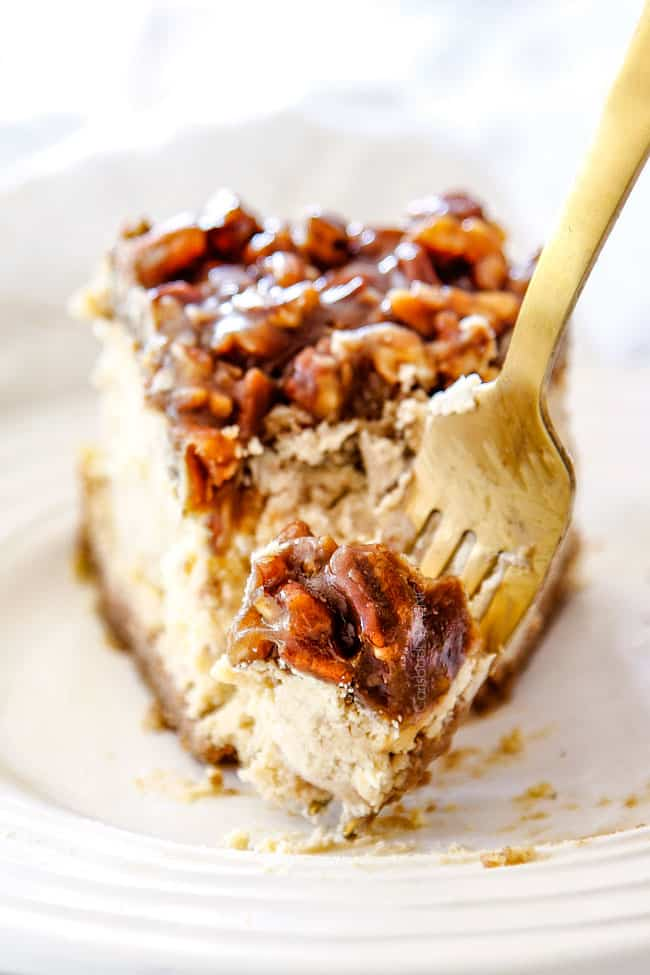 a bite of easy pecan pie cheesecake on a fork