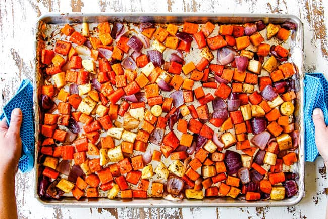 showing how to make roasted root vegetables by taking them out of the oven after roasting for 45 minutes