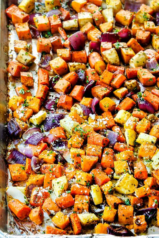 roasted root vegetables on a baking tray with beets, carrots, sweet potatoes, parsnips and butternut squash