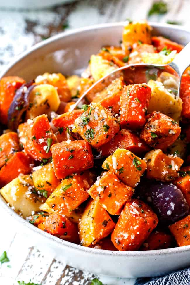 a servings spoon of roasted root vegetables with garlic and Parmesan