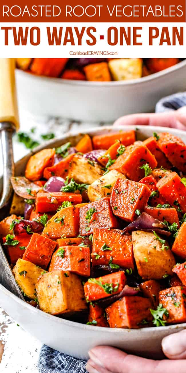 balsamic roasted root vegetables in a white bowl garnished with parsley with a servings spoon