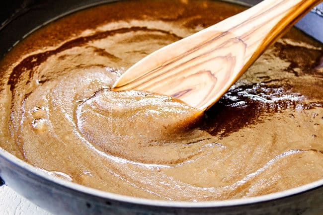 showing how to make caramel popcorn by mixing caramel sauce ingredients together until smooth