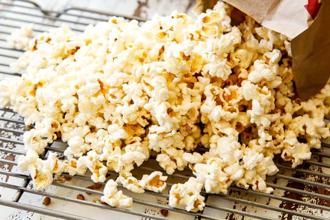 showing how to make caramel corn by separating popcorn kernels from popcorn