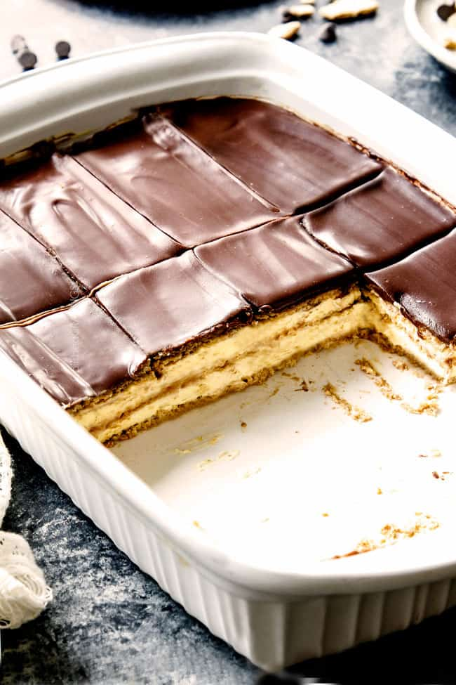 Chocolate Eclair Cake in a 9x13 pan with pieces missing