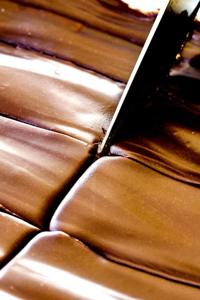 up close of slicing easy Chocolate Eclair Cake