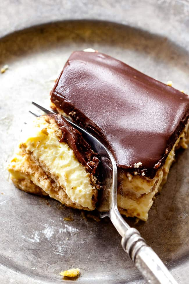 top view of a forking taking a bite of Chocolate Eclair Cake