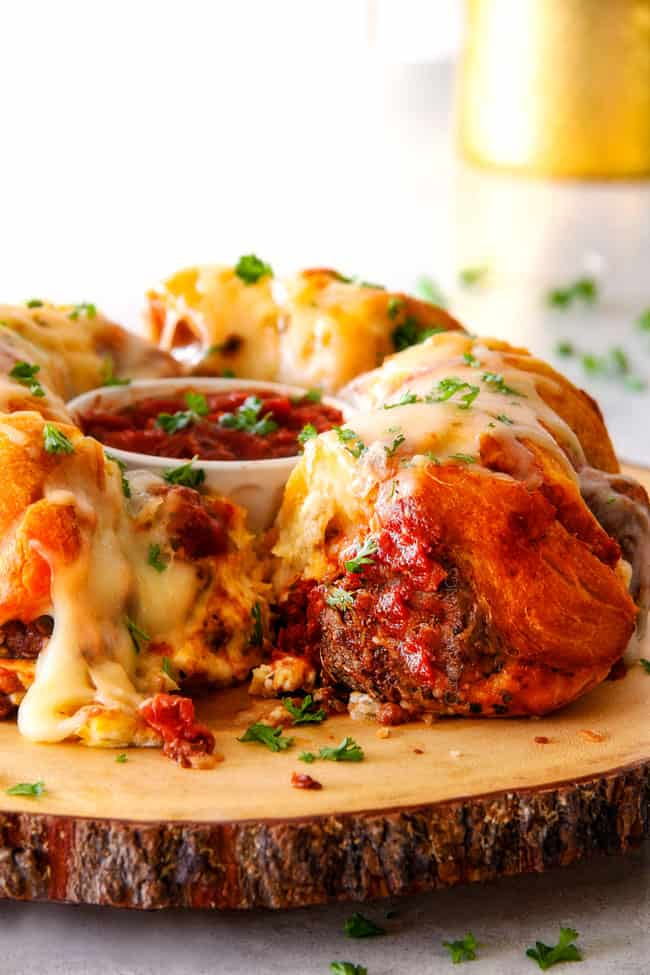far away view of pull apart bread made in a bundt pan with meatballs and cheese