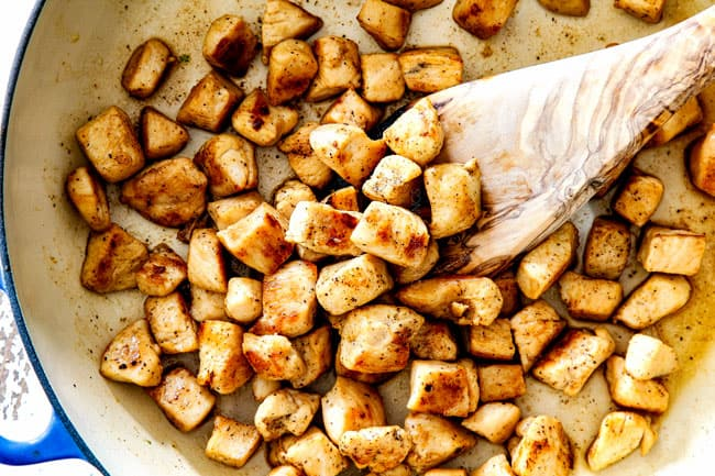showing how to make best chicken divan recipe by cooking chopped chicken in a pan