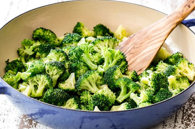 showing how to make chicken divan by steaming broccoli in a blue skillet