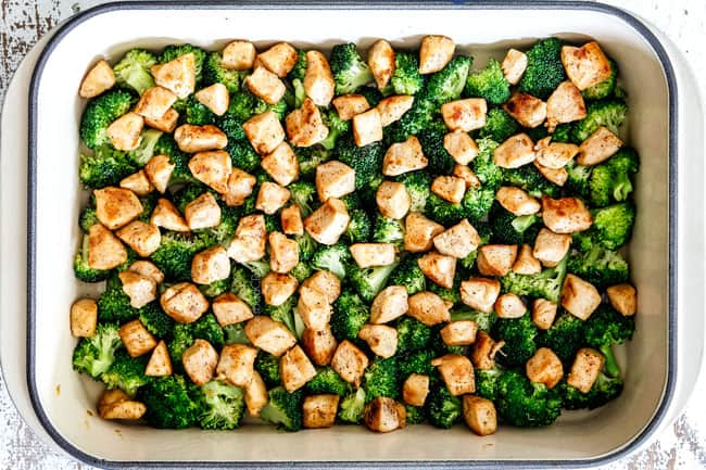 showing how to make easy chicken divan by layering chicken on top of broccoli in a 9x13 casserole dish