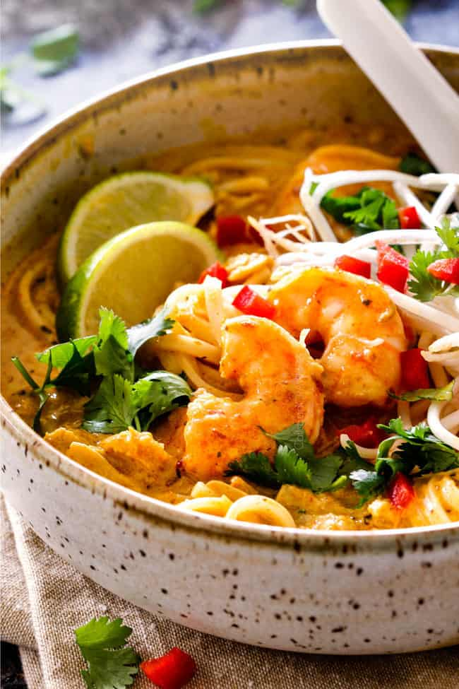 up close side view of Singapore laksa recipe with shrimp, cilantro and lime