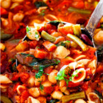 up close of a ladle full of Italian Minestrone Soup with pasta