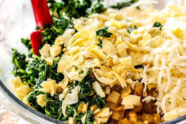 showing how to make spinach and artichoke dip recipe by adding spinach, artichokes, cream cheese, sour cream, mayonnaise, mozzarella and Parmesan cheese to a glass bowl