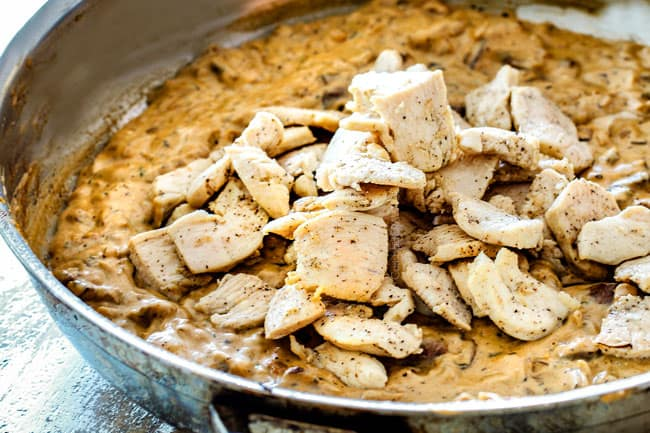 showing how to make Chicken Stroganoff by adding chicken back to Stroganoff sauce