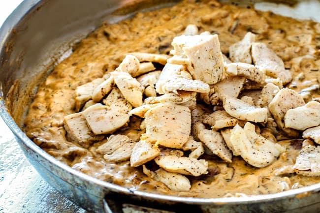 showing how to make Chicken Stroganoff by adding chicken back to Stroganoff sauce