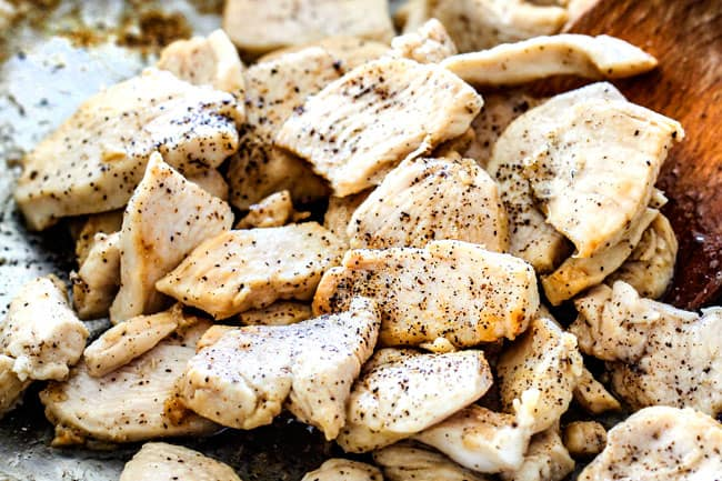 showing how to make Chicken Stroganoff by cooking thinly sliced chicken and seasoning with salt and pepper