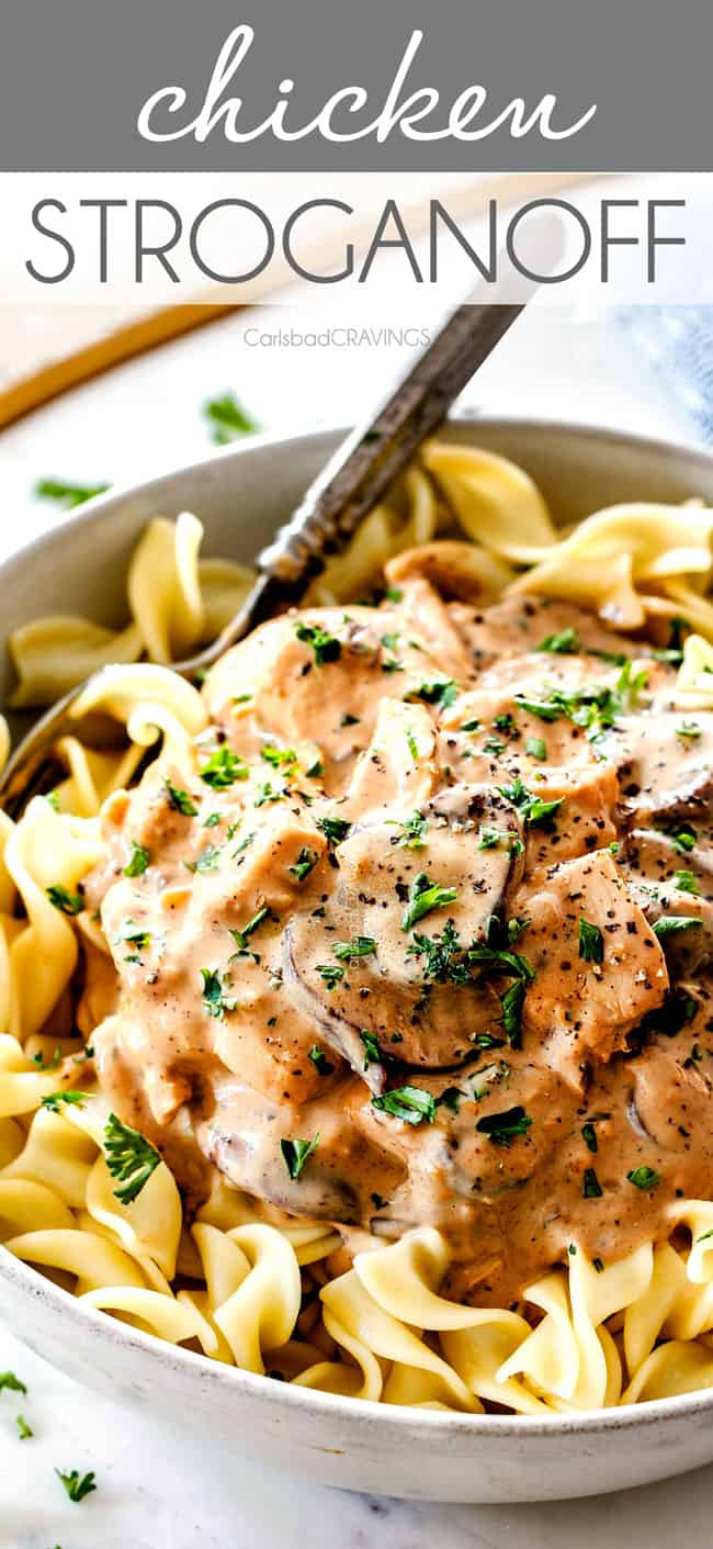 up close of juicy Chicken Stroganoff in a white bowl