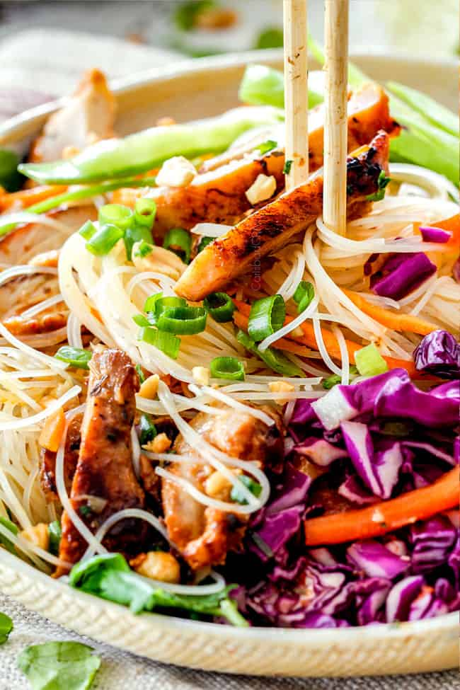 up close of chopsticks picking up Vietnamese Noodles