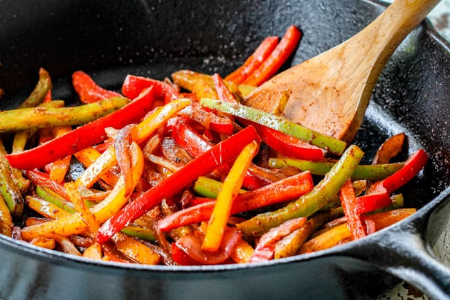 showing how to make pork fajitas by stir frying red, yellow and green bell peppers