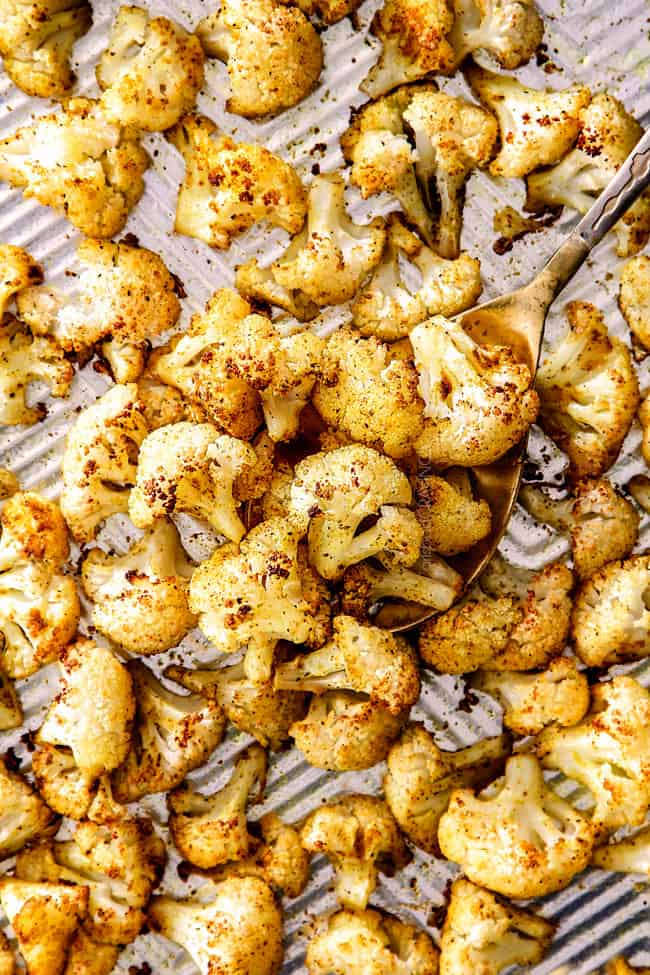 top view of curry roasted cauliflower on a baking sheet