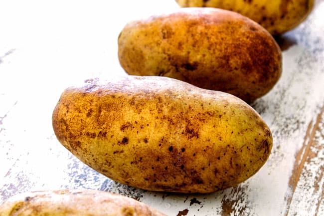 showing the best potatoes to make twice baked potatoes with a row of russet potatoes
