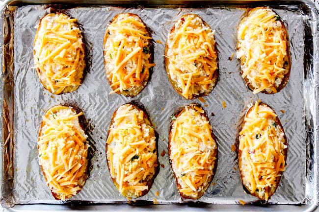 showing how to make twice baked potatoes by lining potato halves on a baking sheet and topping with chese