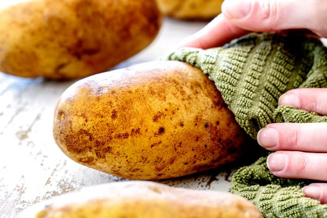 showing how to make twice baked potatoes by washing and drying potatoes with a green cloth