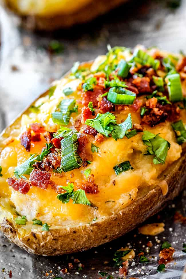 up close side view of twice baked potatoes with sour creraem