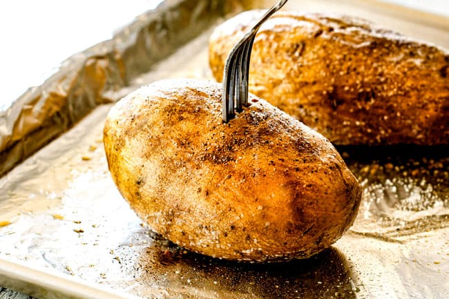 showing how to make twice baked potatoes by piercing with a fork to show they are tener