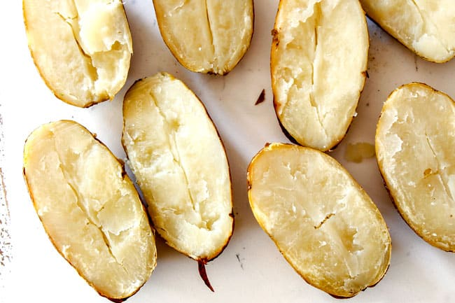 top view of potato halves on a white cutting board