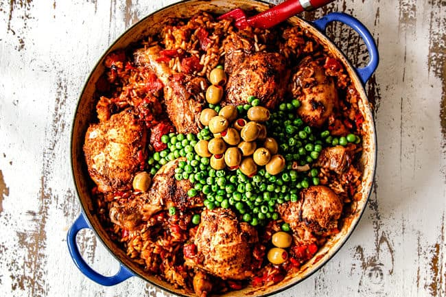 showing how to make Arroz con Pollo by adding peas and olives to baked chicken