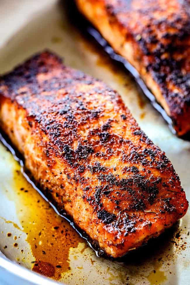 showing how cook blackened salmon in a stainless steel pan
