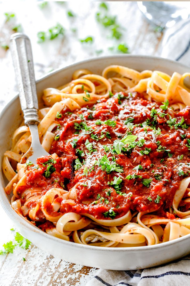 Hearty marinara sauce over pasta with Parmesan