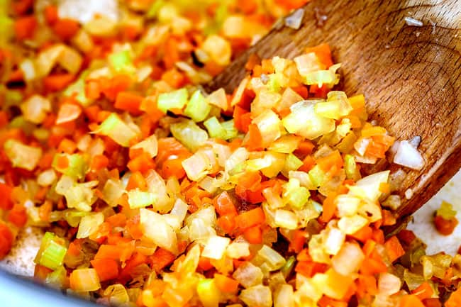 showing how to make marinara sauce by cooking onions, celery and carrots