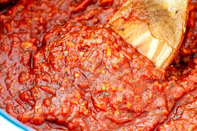 showing how to make marinara sauce by stirring sauce