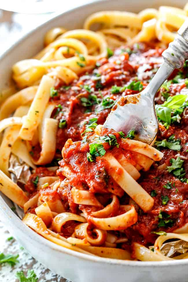 a forkful of noodles with the best Marinara Sauce