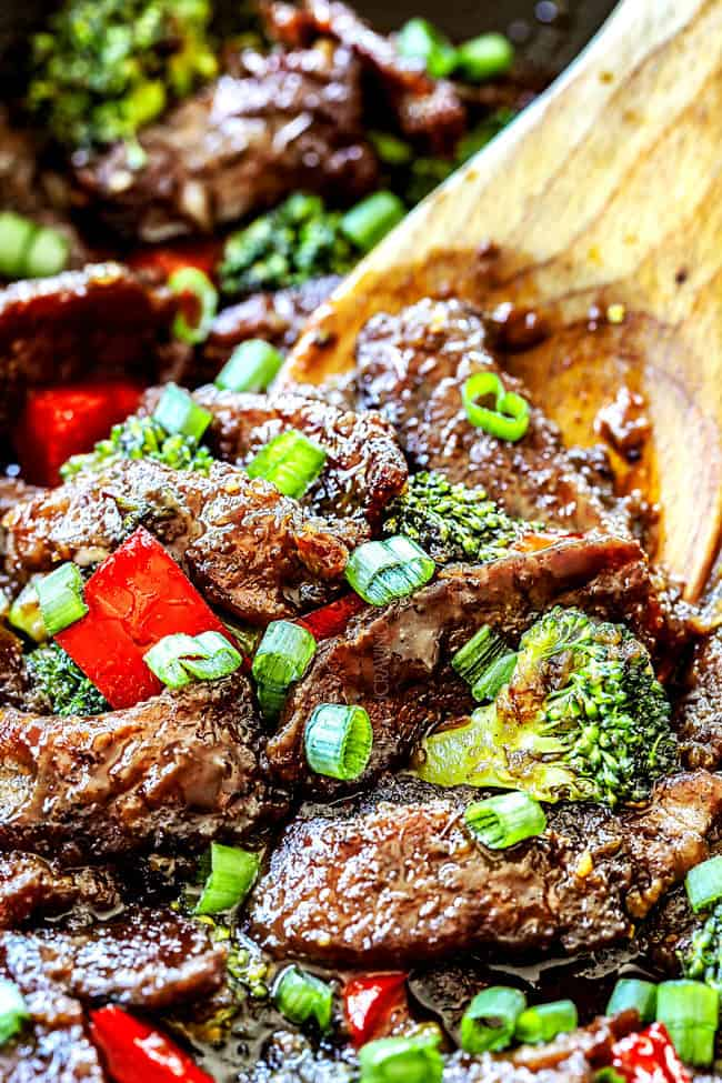 showing how to make Mongolian beef by stirring beef , broccoli and bell peppers together in a skillet