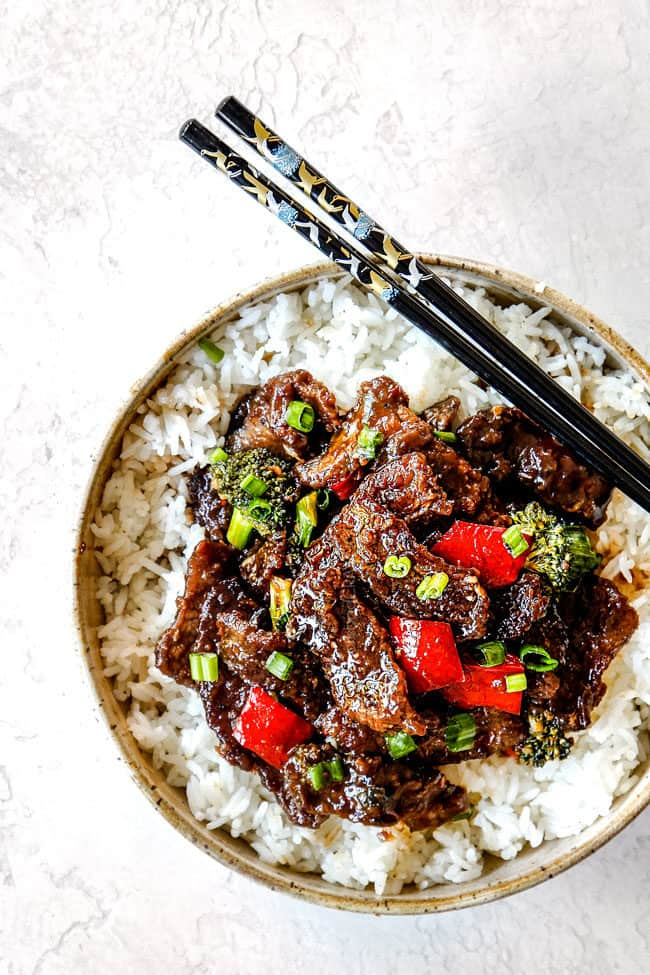 far away top view of authentic Mongolian Beef recipe in a bowl with black chopsticks