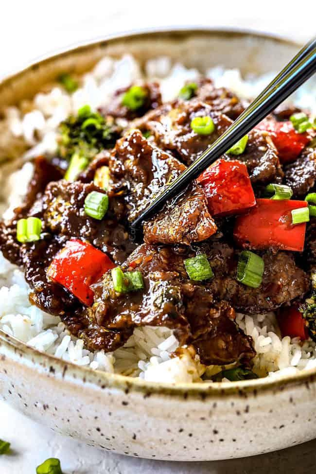 chopsticks picking up the best Mongolian beef