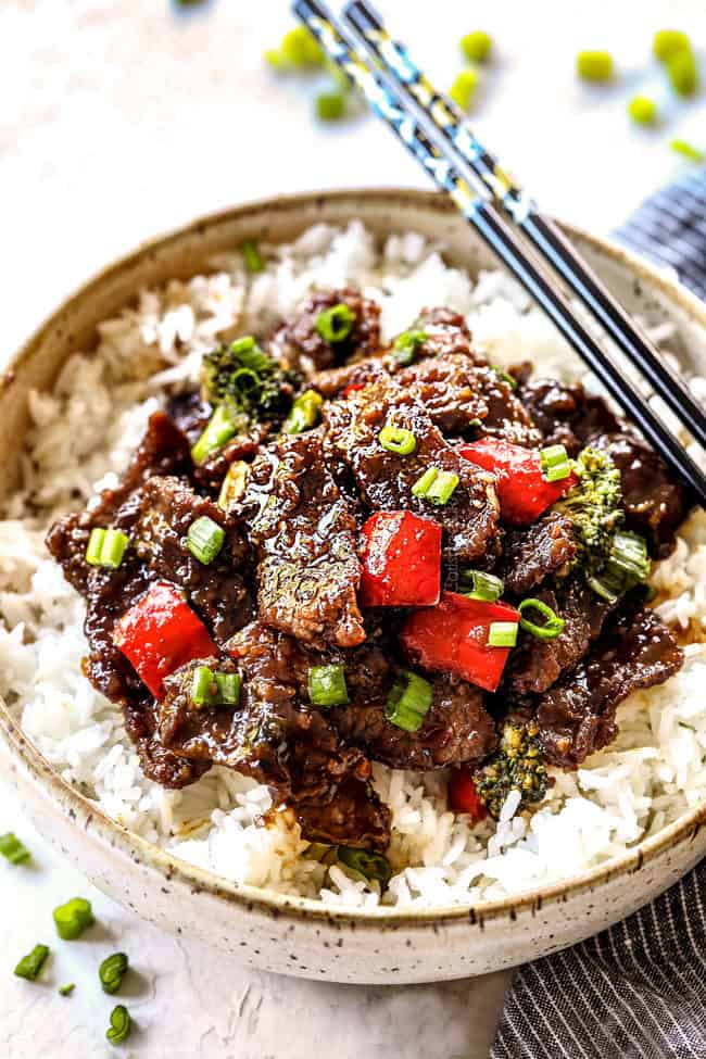 Authentic Mongolian Beef Recipe in a bowl garnished with green onions