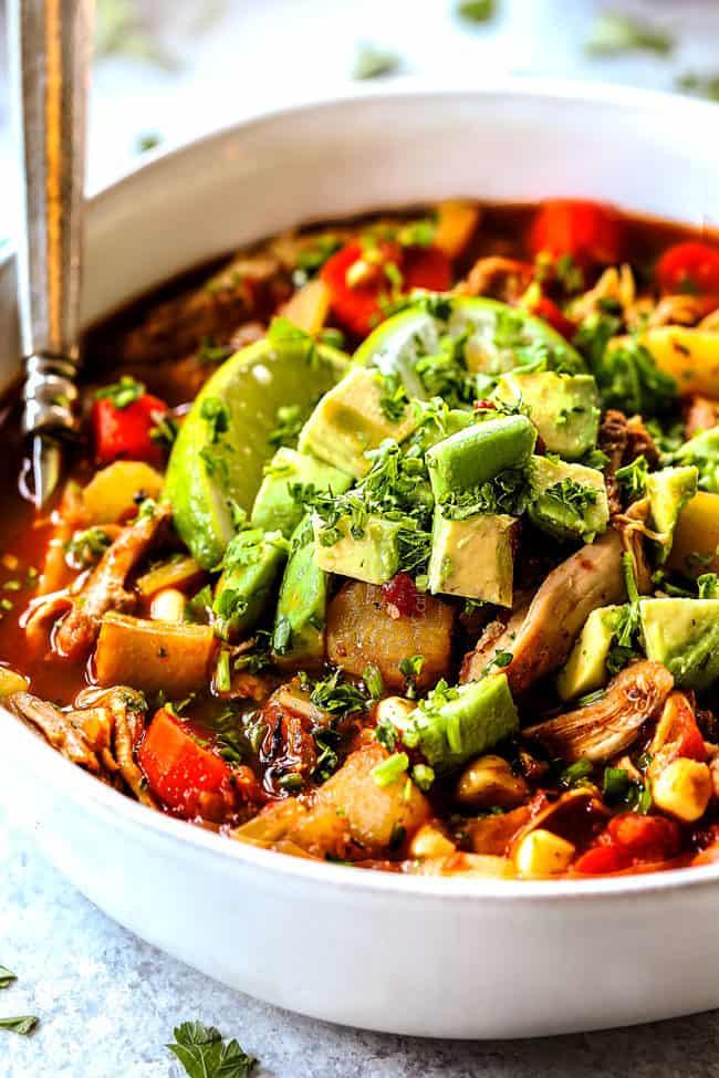 up close of a bowl of authentic Caldo de Pollo (Mexican Chicken Soup) with a silver spoon