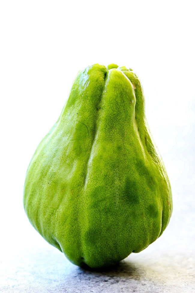 chayote on a cutting board ready to cut for Caldo de Pollo