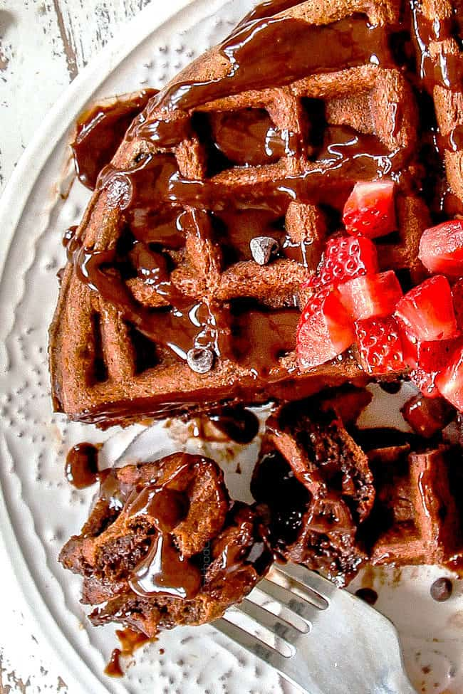 up close view of easy chocolate waffles with a bite on a fork