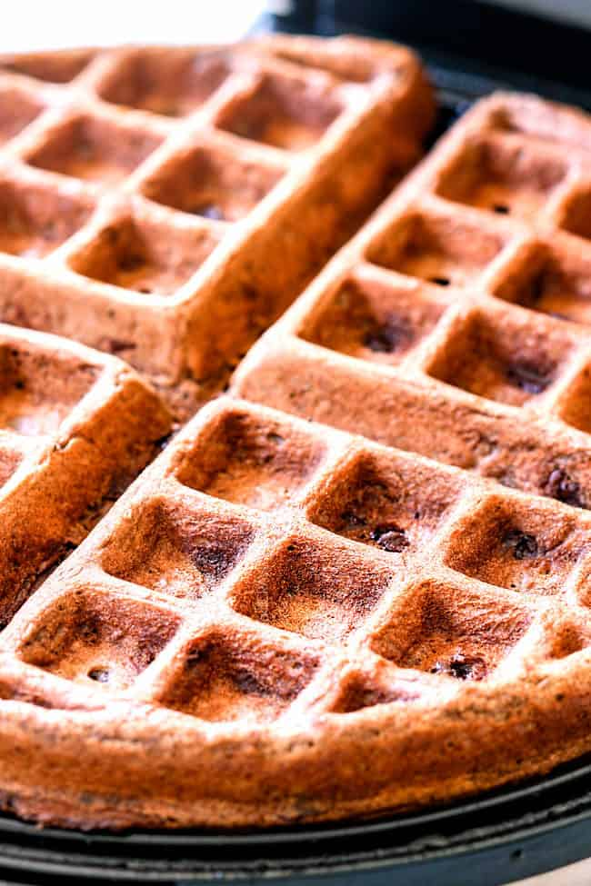 showing how to make chocolate waffles by baking waffles in waffle iron
