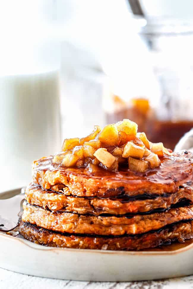 front shot of a stack of healthy sweet potato pancakes with cinnamon apples piled on top